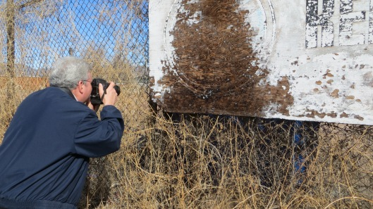 Shooting specific details in a dilapidated sign.